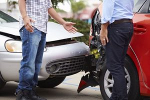 Two Drivers Arguing After Traffic Accident   Technology Could Dramatically Reduce Deadly Rear-End Collisions
