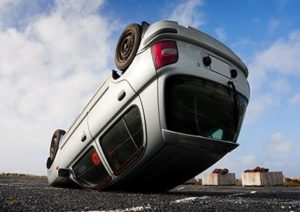 car turned upside-down after road collision | Rollover Accidents Can be Complicated