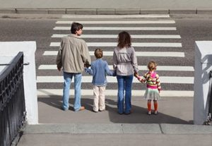 family about to enter crosswalk while holding hands | Auto-Pedestrian Accidents Involving Children