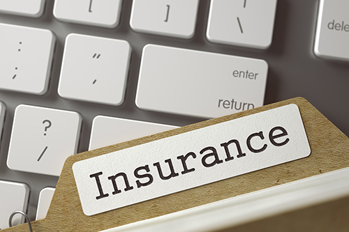 insurance file on keyboard Rising Cost of Car Insurance