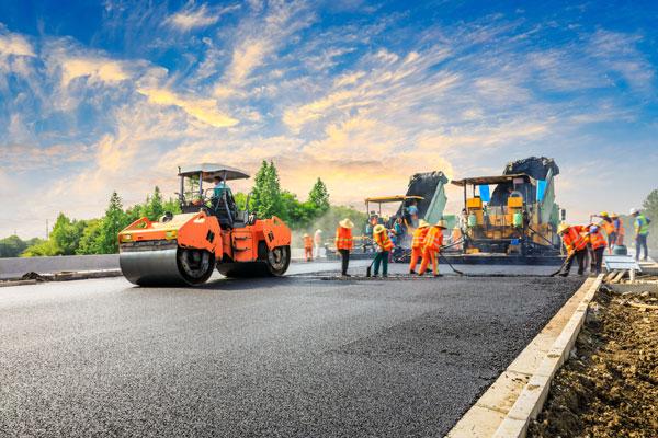 road crew working on repaving asphalt