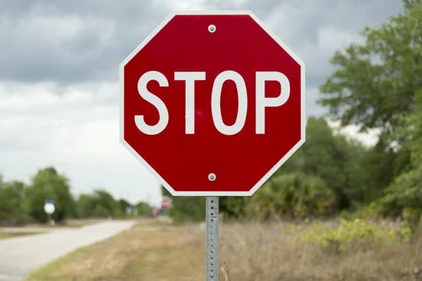stop sign on a rural road