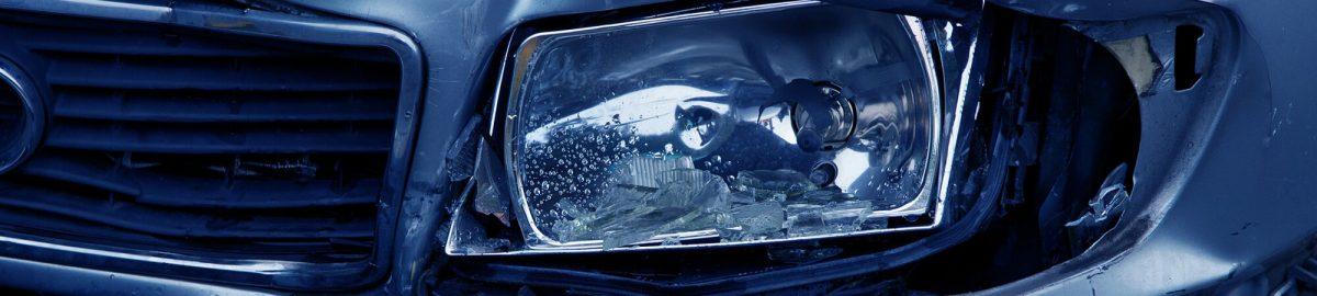 Car with a broken headlight