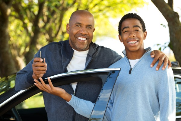 Father teaching his son how to drive   CDOT Graduated Drivers License Laws