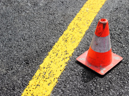 traffic cone next to yellow stripe   Englewood Residents Focus on Safety